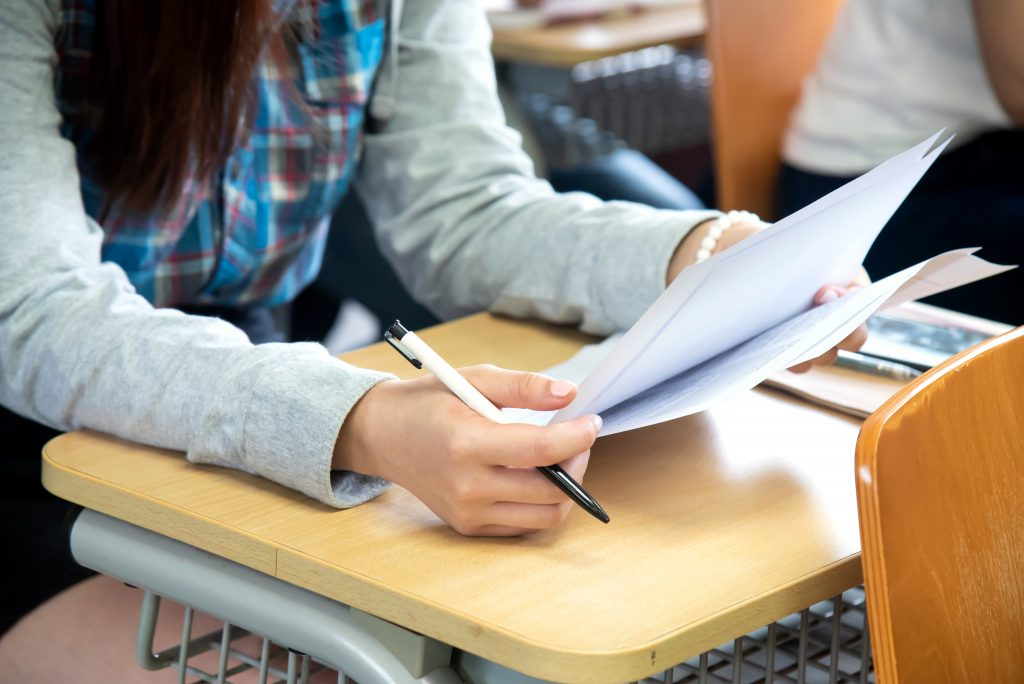 Students having exam in classroom at university